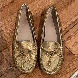 Michael Kors gold loafers